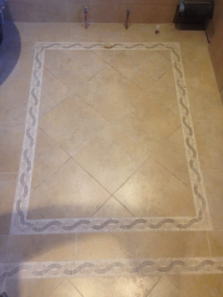 Tiled flooring in Roman style bathroom