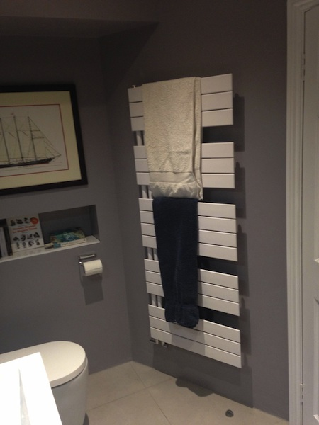 Small bathroom installation in Redland, Bristol - towel rail and inbuilt shelf for books and knick knacks