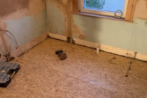 Walls freshly plastered & floor levelled with OSB board & battens